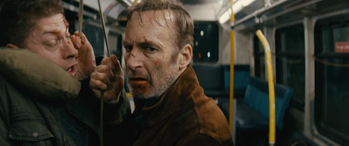 """Bob Odenkirk, with a blood-spattered face, reveals his very special set of action skills in """"Nobody."""""""