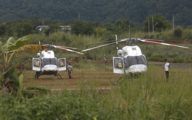 <p>Two helicopters wait near the cave for more evacuations of the boys and their soccer coach who had been trapped since June 23 in a deep cave in Chiang Rai province, northern Thailand, July 9, 2018. (Photo: Sakchai Lalit/AP) </p>