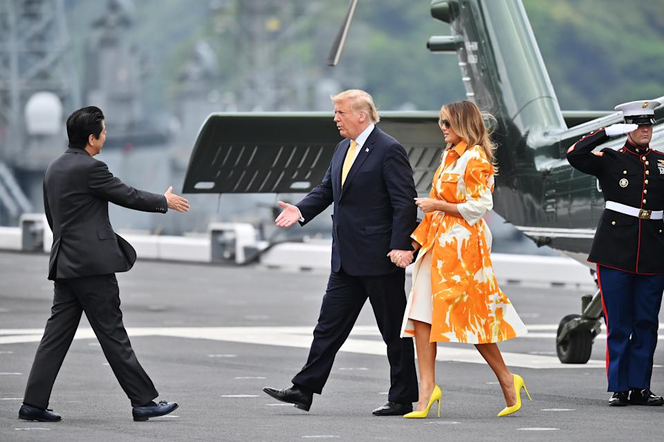 In case you needed further evidence on her fashion know-how, Melania chose a £1,000 Dries Van Noten coat (plucked from the SS19 collection) for the flight home. [Photo: Getty]