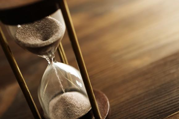 An hourglass on a table.