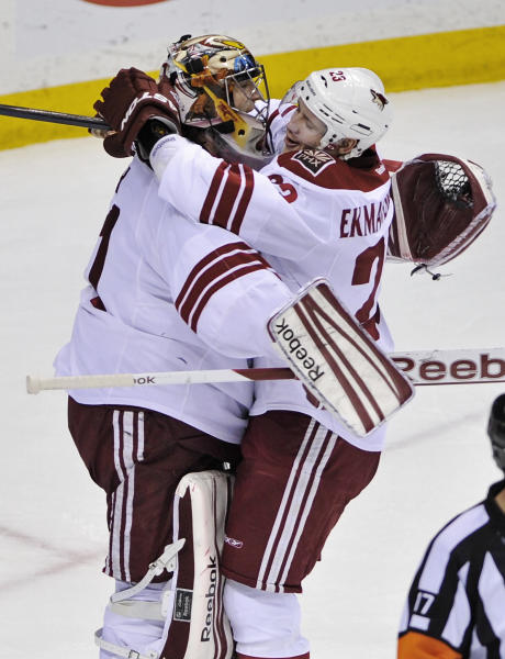 Phoenix Coyotes goalie Mike Smith, left, and Oliver Ekman-Larsson, of Sweden, celebrate after they defeated the against the Minnesota Wild 4-1 in an NHL hockey game on Saturday, April 7, 2012, in St. Paul, Minn. (AP Photo/ Jim Mone)