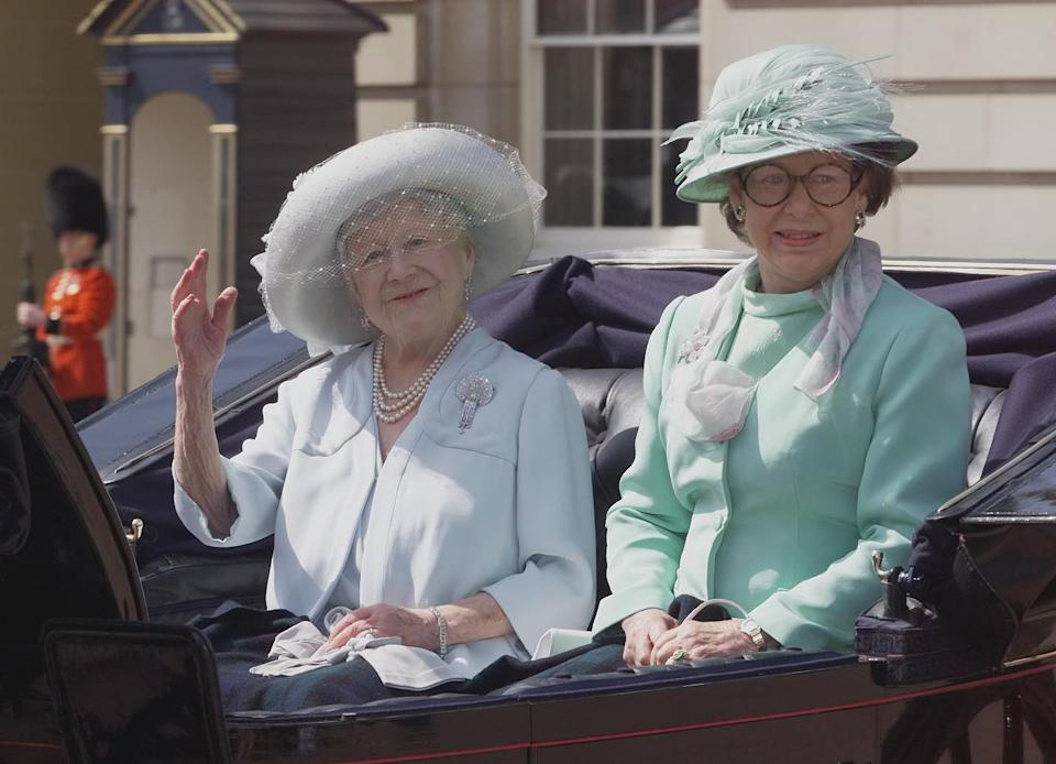 The Queen Mother with Princess Margaret sit in an open top carriage as they leave Buckingham Palace, central London for the short ride to Horse Guards parade, where senior members of the Royal family gather for the annual Trooping the Colour ceremony.   (Photo by John Stillwell - PA Images/PA Images via Getty Images)