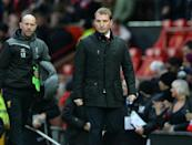 Liverpool's Northern Irish manager Brendan Rodgers walks from the dug-out at half time in the English Premier League football match against Manchester United at Old Trafford on December 14, 2014 (AFP Photo/Oli Scarff)