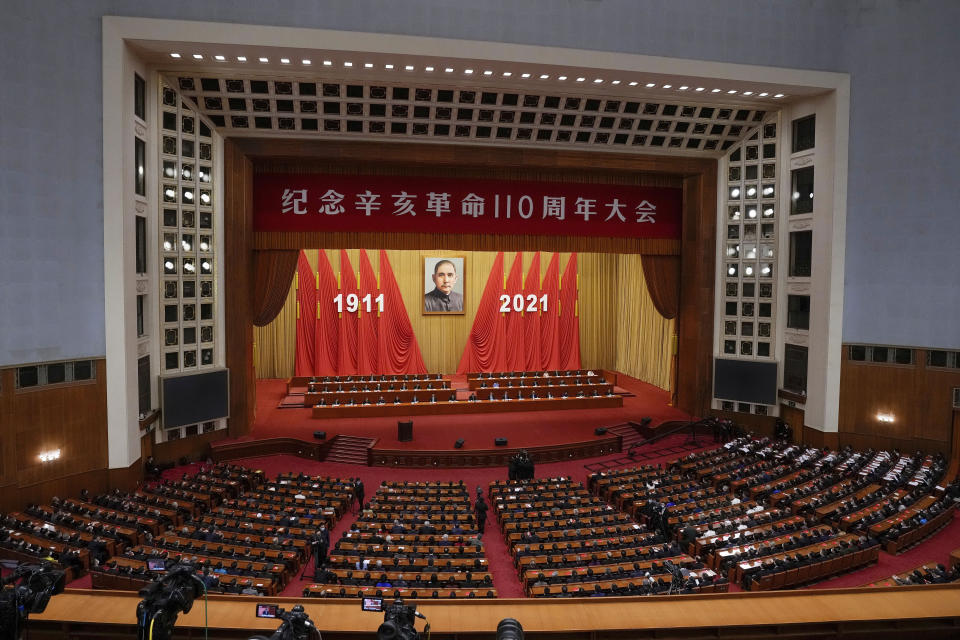 Chinese President Xi Jinping, center on the stage, delivers a speech at an event commemorating the 110th anniversary of Xinhai Revolution at the Great Hall of the People in Beijing, Saturday, Oct. 9, 2021. (AP Photo/Andy Wong)