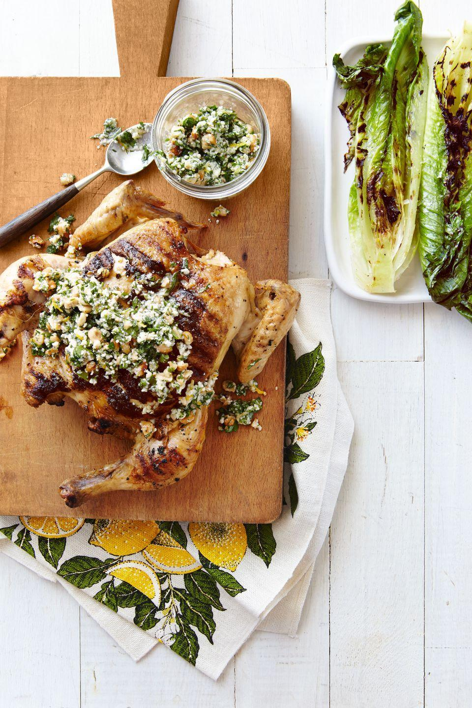 """<p>This grilled chicken deserves a spot in your weekly dinner rotation this spring.</p><p><strong><a href=""""https://www.countryliving.com/food-drinks/recipes/a38079/flattened-chicken-and-grilled-romaine-with-parsley-lemon-sauce-recipe/"""" rel=""""nofollow noopener"""" target=""""_blank"""" data-ylk=""""slk:Get the recipe"""" class=""""link rapid-noclick-resp"""">Get the recipe</a>.</strong></p>"""