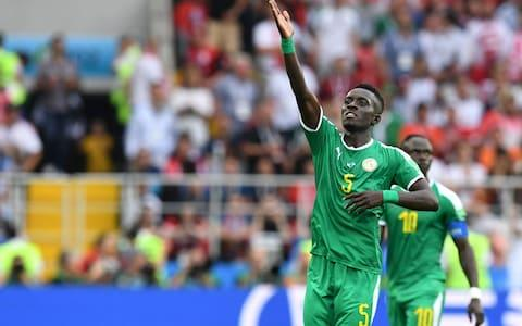 Senegal's midfielder Idrissa Gana Gueye reacts after Poland's conceded a goal - Credit: AFP