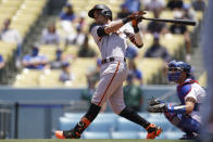 San Francisco Giants' Mauricio Dubon (1) hits a home run during the first inning of a baseball game against the Los Angeles Dodgers Sunday, May 30, 2021, in Los Angeles. Donovan Solano also scored. (AP Photo/Ashley Landis)