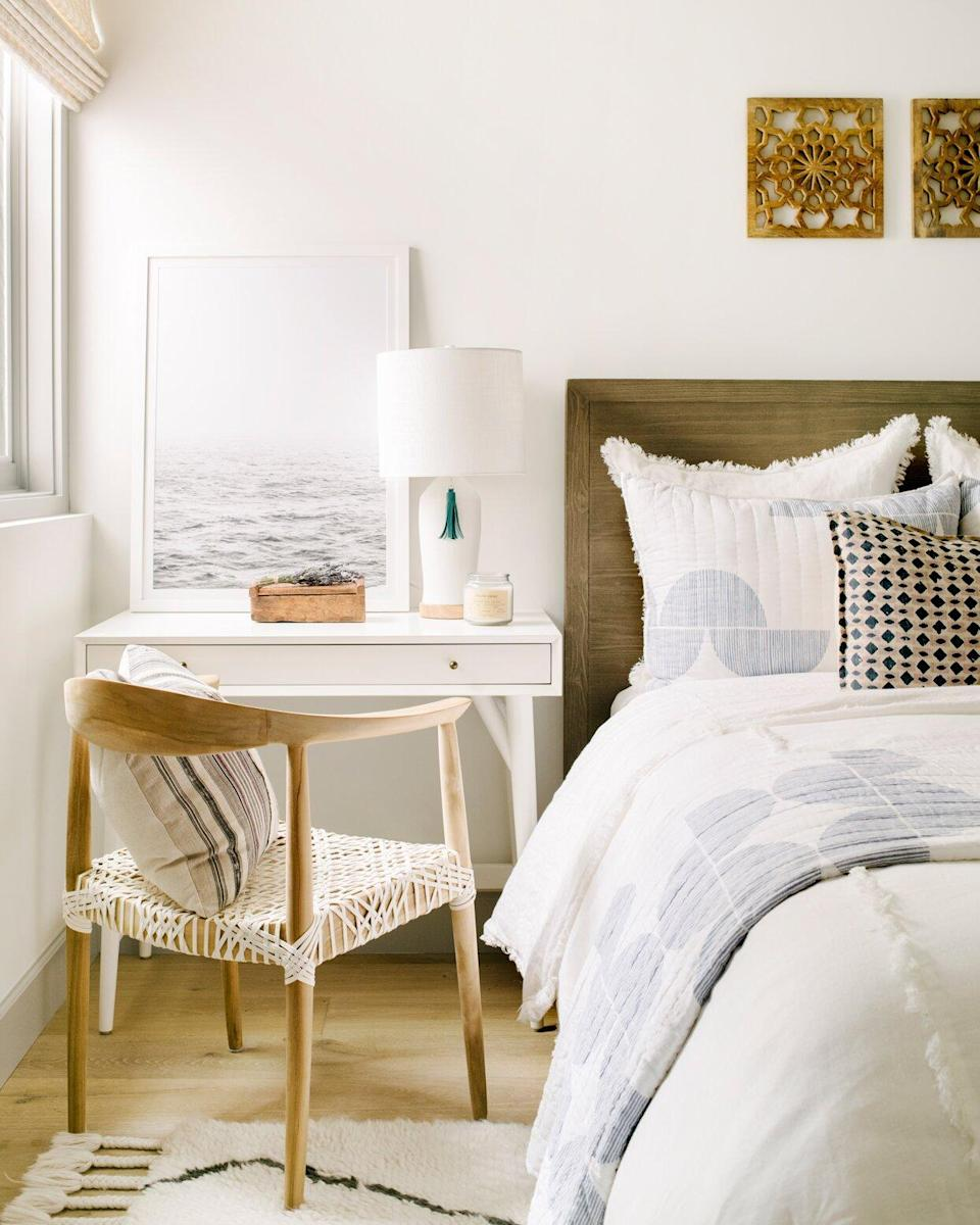 white desk wooden chair next to bed