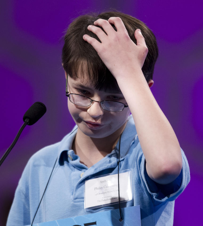 Philip Andrew Cummings of Oswego, N.Y., concentrates during the third round of the National Spelling Bee, Wednesday, May 30, 2012, in Oxon Hill, Md. (AP Photo/Evan Vucci)