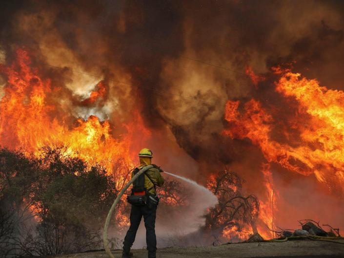 San Miguel County Firefighters battle a brush fire along Japatul Road during the Valley Fire in Jamul, California over the weekend (Getty)
