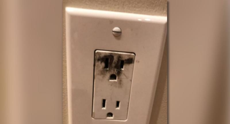 A damaged wall socket pictured following the TikTok challenge. Source: Massachusetts Department of Fire Services