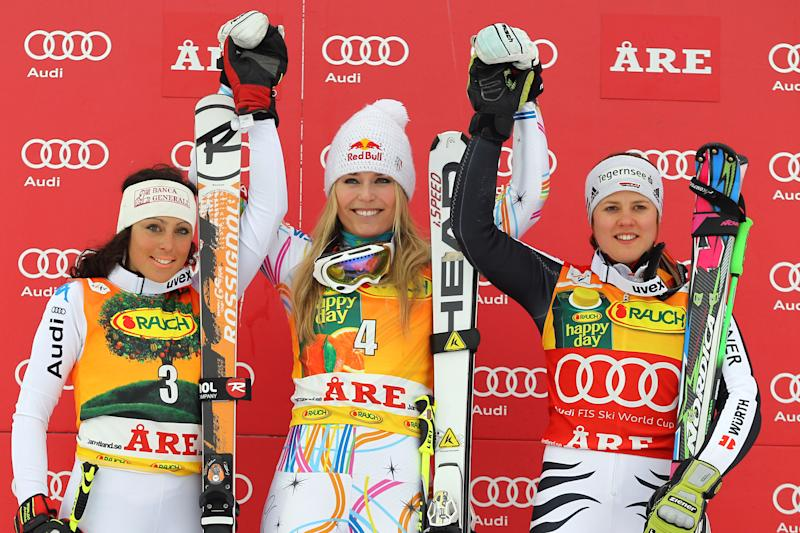United States's Lindsey Vonn, center, the winner, celebrates on podium with Italy's Federica Brignone, left, second placed placed, and Germany's Viktoria Rebensburg, third, after a women's Alpine Ski World cup giant slalom competition in Are, Sweden, Friday, March 9, 2012. (AP Photo/Alessandro Trovati)