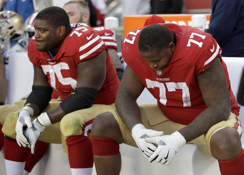 49ers guard Laken Tomlinson (75) and tackle Trent Brown (77) sit on the bench as the team fell to 0-9. (AP)