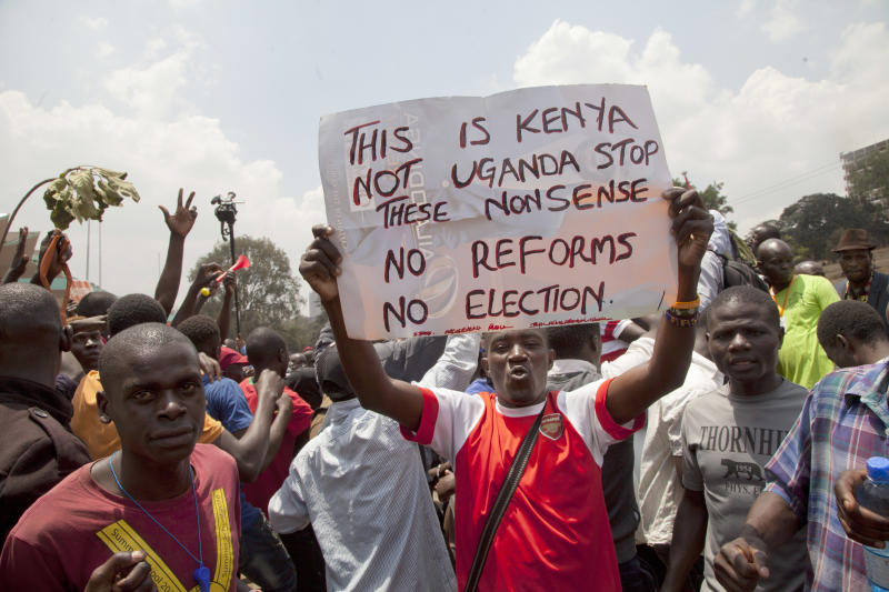National Super Alliance (NASA) supporter hold a poster as hundreds demonstrate in Nairobi, Kenya, Wednesday Oct. 11, 2017. The protesters are demanding a change of leadership at the country's election commission. The protests took place in the capital Nairobi and the opposition stronghold of Kisumu, in western Kenya, as well as in the coastal city of Mombasa.(AP Photo/Sayyid Abdul Azim)