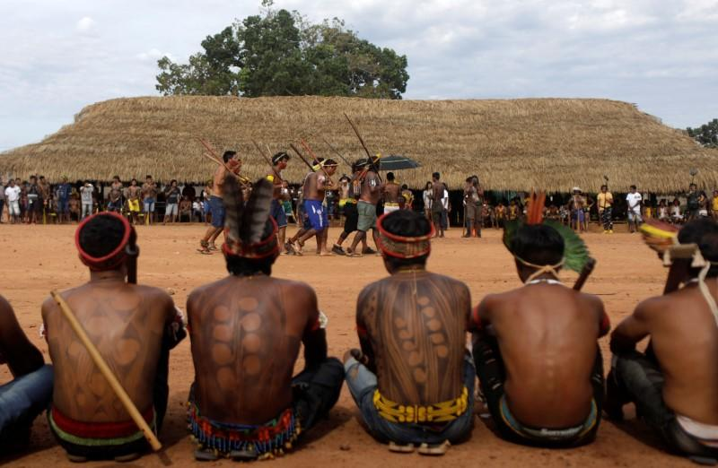 Indigenous people perform during a four-day pow wow in Piaracu village near Sao Jose do Xingu