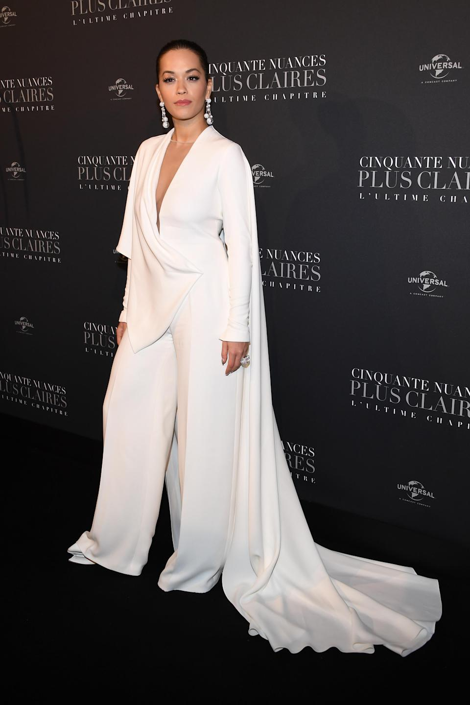 <p>The singer, who stars in the film, wore an all-white Stephane Rolland ensemble – complete with cape. <em>[Photo: Getty]</em> </p>