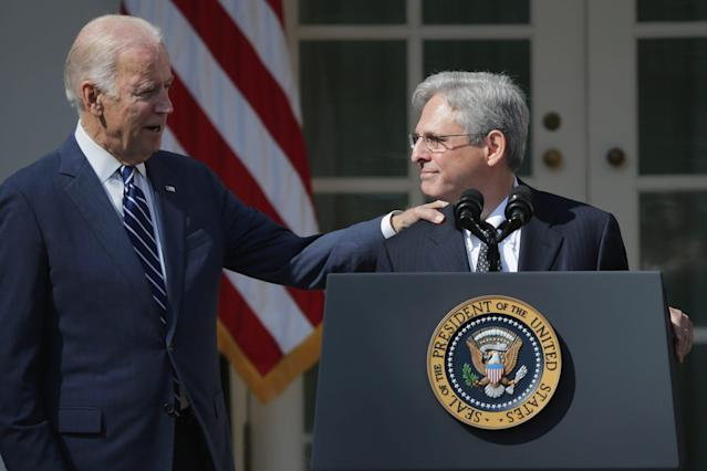 President-elect Joe Biden has reportedly chosen federal appeals court judge Merrick Garland as his attorney general  Seen here then Vice President Joe Biden congratulates Judge Merrick Garland after he was nominated by President Barack Obama to the Supreme Court in the Rose Garden at the White House March 16 2016 in Washington DC