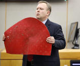 Assistant District Attorney Jason Hermus shows Botham Jean's doormat to the jury during his opening statement before the jury during former Dallas police Officer Amber Guyger''s trial in Dallas, Monday, Sept. 23, 2019. Guyger is accused of shooting Jean, her black neighbor in his Dallas apartment.(Tom Fox/The Dallas Morning News via AP, Pool)