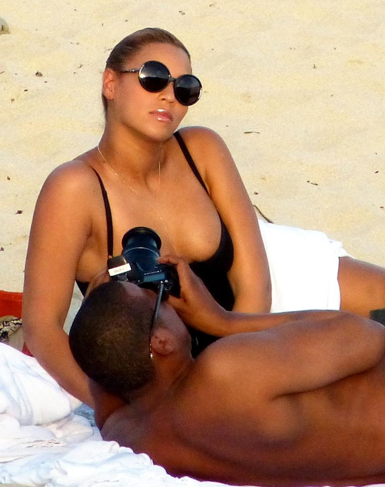 To celebrate their fourth wedding anniversary, Beyonce recently launched a Tumblr blog that was filled with personal photos of her and her husband. On the beach, Jay-Z snapped some more pics of the singer while they lounged on the beach in their matching black bathing suits. (04/09/2012)