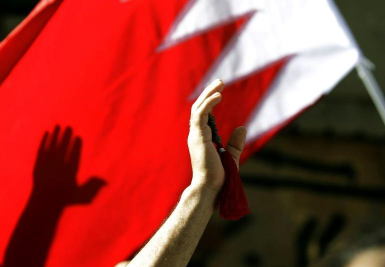 A Bahrain flag is waved during a Shiite funeral in the capital Manama, in this file photo taken on March 22, 2011