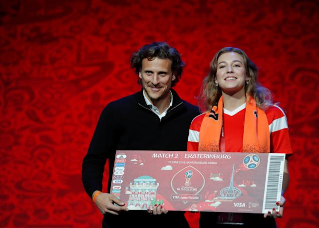 Draw assistants Diego Forlan of Uruguay poses with a soccer fan on stage after a rehearsal on the eve of the Final Draw for the 2018 FIFA World Cup in Moscow, Russia, November 30, 2017. REUTERS/Maxim Shemetov