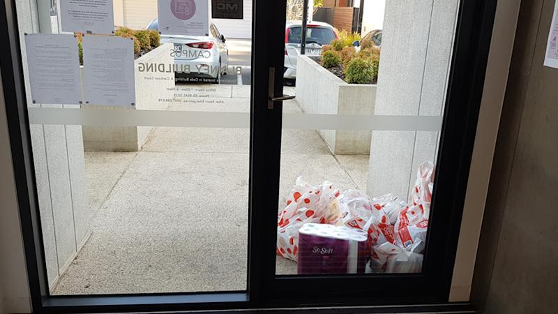 A Coles online delivery order that was place directly by a building door blocking the entrance