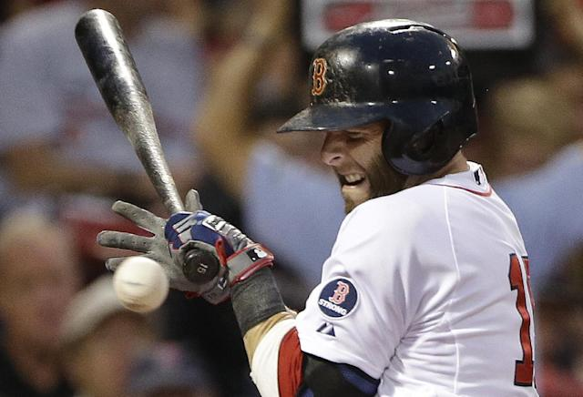Boston Red Sox's Dustin Pedroia reacts as he is hit by a pitch during the third inning of a baseball game against the Tampa Bay Rays at Fenway Park in Boston Tuesday, July 23, 2013. (AP Photo/Elise Amendola)