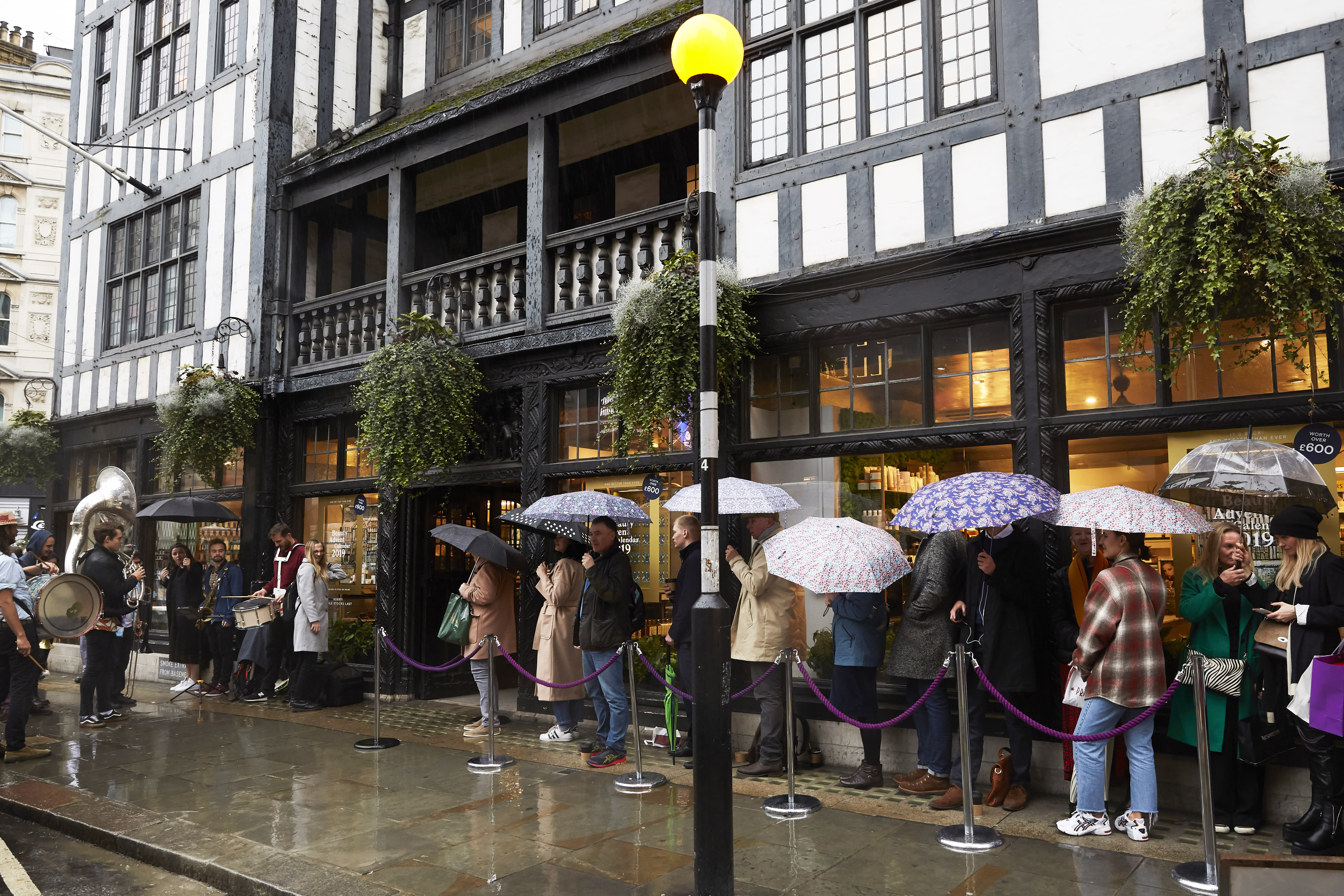 Eager customers queued in the rain from 6am to make sure they got this years advent calendar. [Photo: Liberty London]