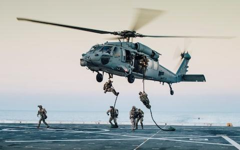 US Coast Guardsmen with Maritime Security Response Team East, Advanced Interdiction Team Detachment 1, during a training exercise in the Gulf - Credit: Reuters
