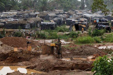 A camp for gold prospectors is seen around a gold mine near the village of Gamina in western Ivory Coast, March 16, 2015. REUTERS/Luc Gnago