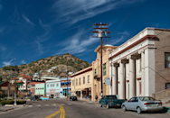 """<p>Back in the day, <a href=""""https://www.tripadvisor.com/Tourism-g31171-Bisbee_Arizona-Vacations.html"""" rel=""""nofollow noopener"""" target=""""_blank"""" data-ylk=""""slk:Bisbee was a major silver and copper mining hub"""" class=""""link rapid-noclick-resp"""">Bisbee was a major silver and copper mining hub</a>, but now it's a quaint small town home to artists and retirees. With houses on cliffs' edges and a mine cavern that you can still explore, it's pretty picturesque. </p>"""