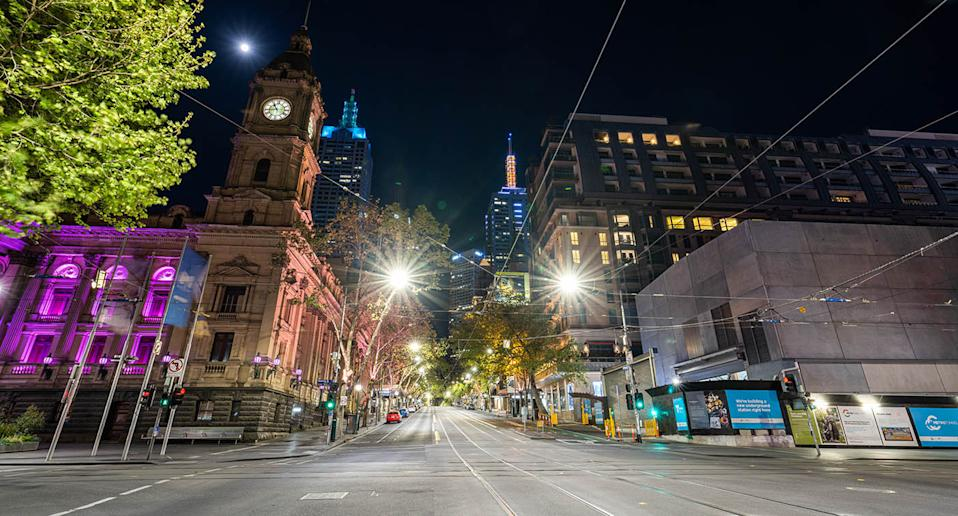 Empty streets near Melbourne Town Hall on the corner of Collins and Swanston street during Melbourne's Covid-19 restrictions.