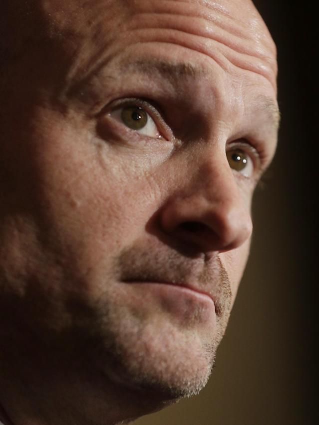 Mississippi coach Andy Kennedy talks with reporters during Southeastern Conference NCAA college basketball media day in Birmingham, Ala., Wednesday, Oct. 16, 2013. (AP Photo/Dave Martin)
