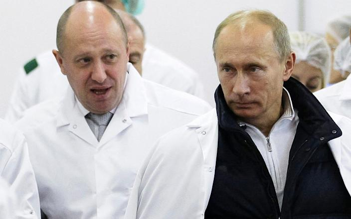 The campaign was attributed to sanctioned businessman Yevgeny Prigozhin, seen here showing Vladimir Putin a school lunch production facility in 2010 - POOL SPUTNIK KREMLIN