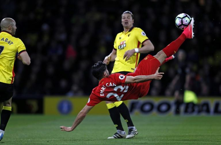 Liverpool's midfielder Emre Can connects with this overhead kick to score against Watford at Vicarage Road Stadium in Watford, north of London on May 1, 2017