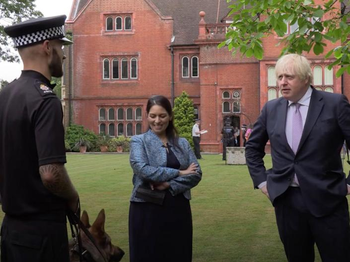 The prime minister and home secretary on a visit to Surrey Police HQ  (YouTube )