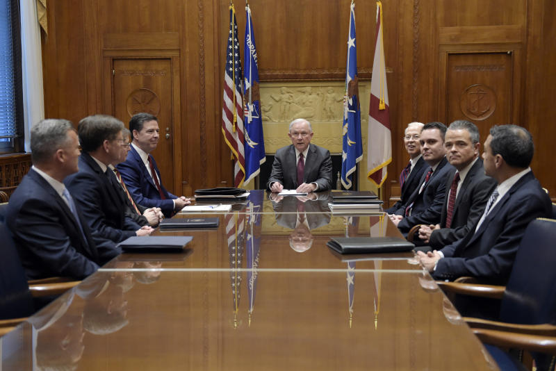 FILE - In this Feb. 9, 2017 file photo, Attorney General Jeff Sessions holds a meeting with the heads of federal law enforcement components at the Department of Justice in Washington, Thursday, Feb. 9, 2017. Seated at the table are, from left, ATF Acting Director Thomas Brandon, U.S. Marshals Acting Director David Harlow, DEA Acting Administrator Chuck Rosenberg, FBI Director James Comey, Sessions, center, Acting Deputy Attorney General Dana Boente, Acting Principal Associate Deputy Attorney General James Crowell, Attorney General Chief of Staff Jody Hunt and Associate Deputy Attorney General Armando Bonilla. Boenete, an understated career federal prosecutor, has found himself at the epicenter of several of the Trump administration's biggest controversies. (AP Photo/Susan Walsh, Pool)