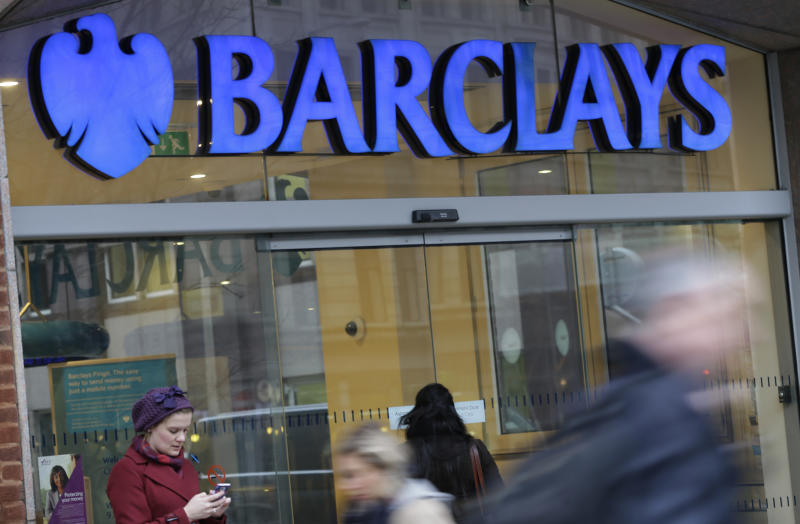 Customers wait outside a retail branch of Barclays Bank for the bank to open in London, Tuesday, Feb. 12, 2013. Barclays PLC has announced plans to cut at least 3,700 jobs in a major restructuring that follows a scandal-hit year for the U.K. bank. The bank said Tuesday it will cut at least 1,800 positions in the Corporate and Investment Bank unit and 1,900 retail and business banking jobs outside the U.K. The cuts come after the British institution was forced to pay a $453 million fine for manipulating a key market interest rate that serves as the basis for trillions in mortgage loans. (AP Photo/Alastair Grant)