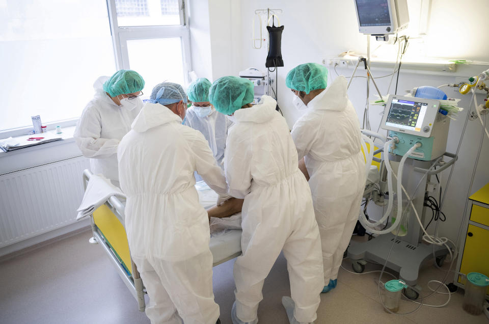 Doctors and nurses attend to a patient at the intensive care unit for COVID-19 patients in the Andras Josa hospital in Nyiregyhaza, Hungary, Thursday, Nov. 26, 2020 (Attila Balazs/MTI via AP).