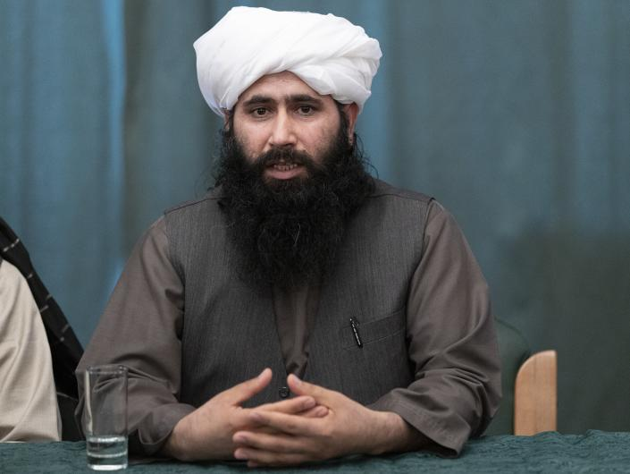 """Member of Taliban's negotiation team , Mohammad Naeem, spokesman for the Taliban's political office speaks to the media during a joint news conference in Moscow, Russia, Friday, March 19, 2021. The Taliban warned Washington against defying a May 1 deadline for the withdrawal of American and NATO troops from Afghanistan, and promising a """"reaction,"""" if the deadline is not met. (AP Photo/Alexander Zemlianichenko, Pool)"""