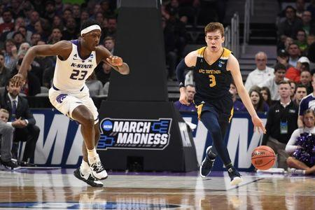 Mar 22, 2019; San Jose, CA, USA; UC Irvine Anteaters guard Robert Cartwright (3) dribbles as Kansas State Wildcats forward Austin Trice (23) defends during the second half in the first round of the 2019 NCAA Tournament at SAP Center. Mandatory Credit: Kelley L Cox-USA TODAY Sports