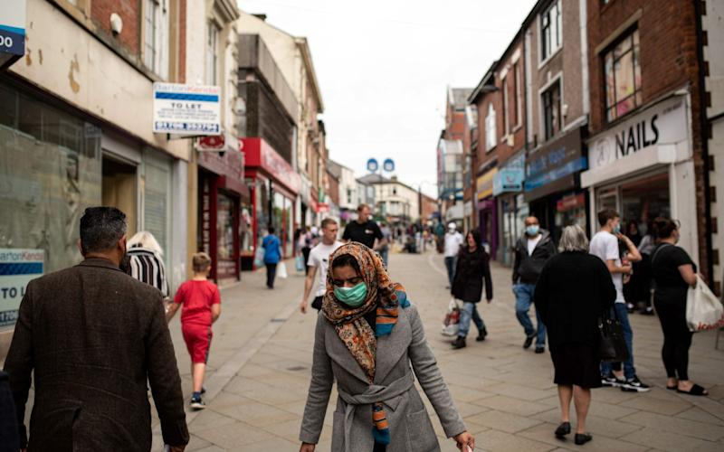In August, new restrictions were imposed on Oldham as part of measures to prevent a second peak - OLI SCARFF/AFP