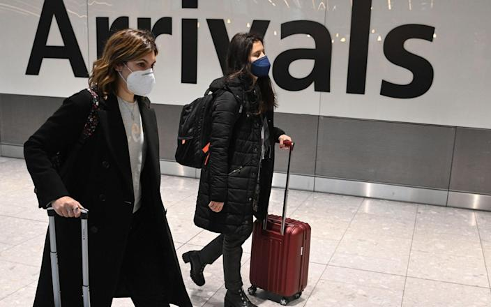 Travelers in the international arrival area of Heathrow Airport near London, Britain, 15 January 2021 - Shutterstock/NEIL HALL