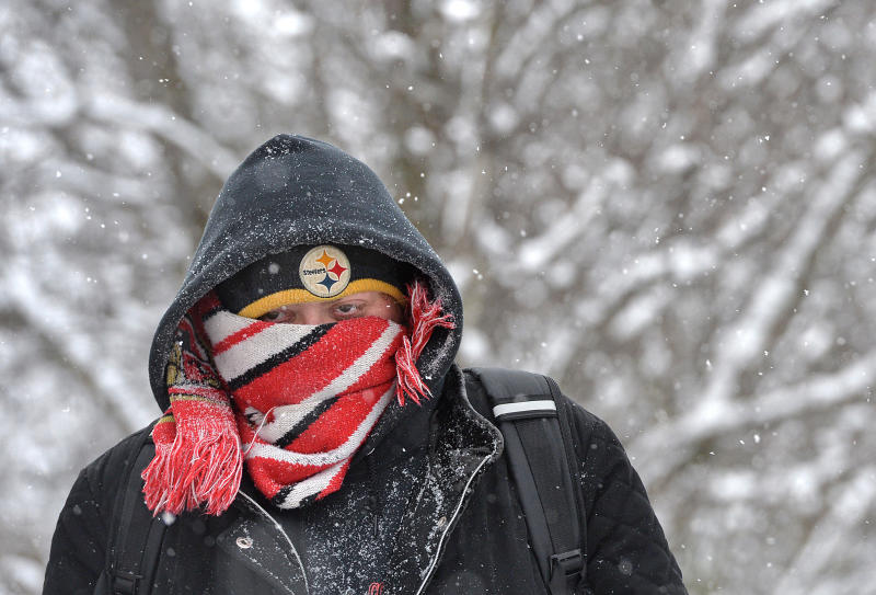 Sireah Drzewiecki, 31, walks to work along Peach Street in Millcreek Township, Erie County, Pa., on Friday, Feb. 14, 2020. Braving 16-degree temperatures and a -9 wind chill, Drzewiecki, made the 25-minute walk from her home to her job. The Erie region saw the lowest temperatures of the year Friday morning. (Christopher Millette/Erie Times-News via AP)