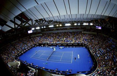 France's Jo-Wilfried Tsonga serves during his third round match against compatriot Pierre-Hugues Herbert, with the roof closed at Margaret Court Arena, at the Australian Open tennis tournament at Melbourne Park, Australia, January 22, 2016. REUTERS/Jason O'Brien