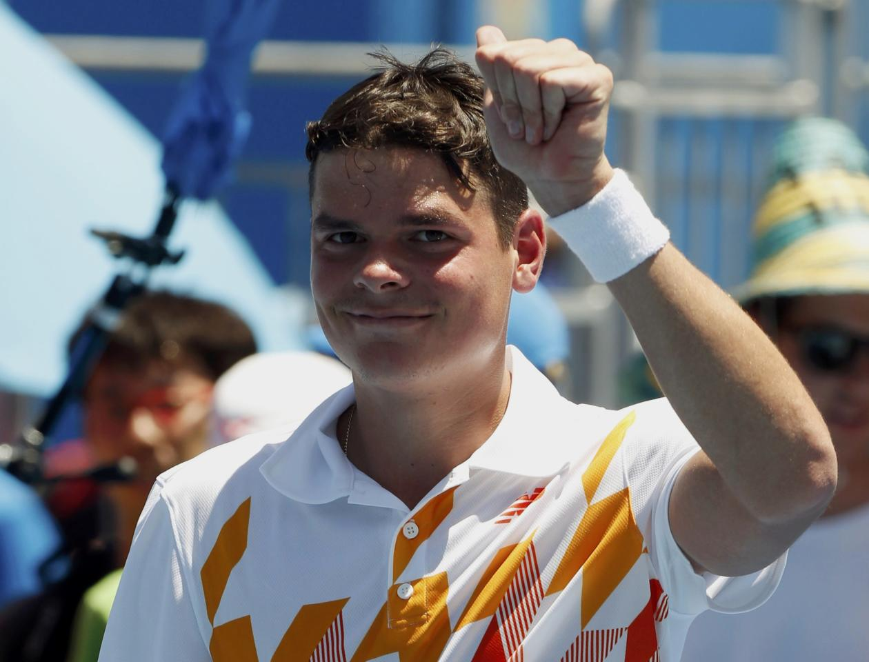 Milos Raonic of Canada acknowledges the crowd after defeating Daniel Gimeno-Traver of Spain in their men's singles match at the Australian Open 2014 tennis tournament in Melbourne January 14, 2014. REUTERS/Brandon Malone (AUSTRALIA - Tags: SPORT TENNIS)