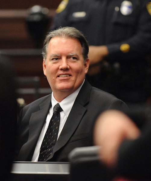 Michael Dunn smiles at his parents during a break in his trial in Jacksonville, Fla. Wednesday, Feb. 12, 2014. Dunn is charged in the shooting death of Jordan Davis in November 2012. (The Florida Times-Union, Bob Mack, Pool)