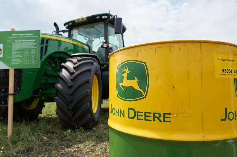 Goryainovka, Mordovia, Russia - June 28, 2019: The John Deere logo seen on JD Plus-50 15W-40 motor oil barrel.