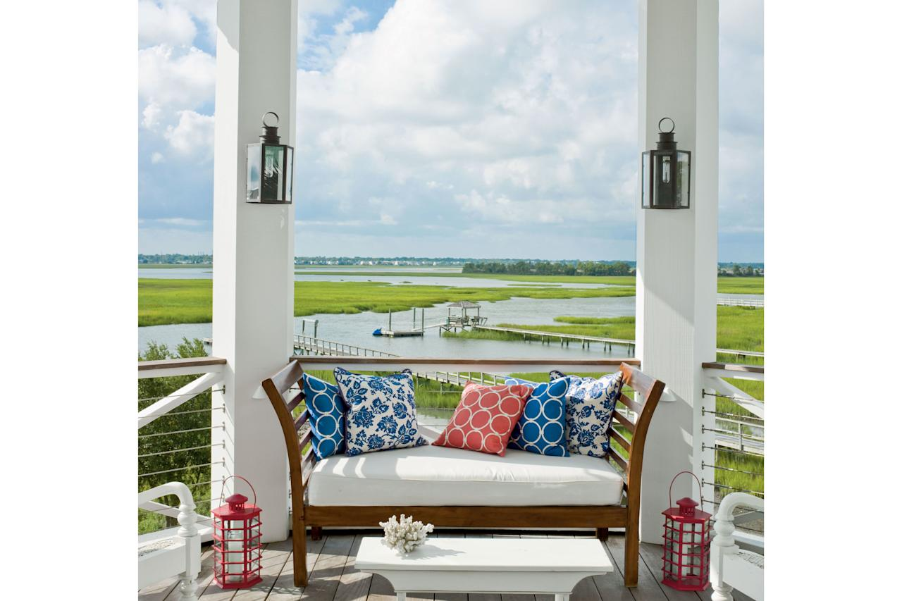 <p><b>What you see:</b> floor-to-ceiling vistas of the Lowcountry marshes lining the Intracoastal Waterway</p> <p><b>What you don't see:</b> view-obscuring railings. Metal cables run horizontally between the posts for safety and a sleek nautical detail without blocking the seascape. The Herlongs called on a friend who rigs sailboats for the job. Highlight of the house: saying goodnight to the sun from three stories up. The octagonal porch becomes the perfect perch for taking in the sunset at happy hour.</p>