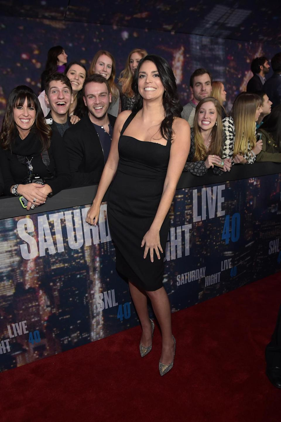Cecily Strong hams it up with her adoring fans while wearing a '90s-like LBD with spaghetti straps.